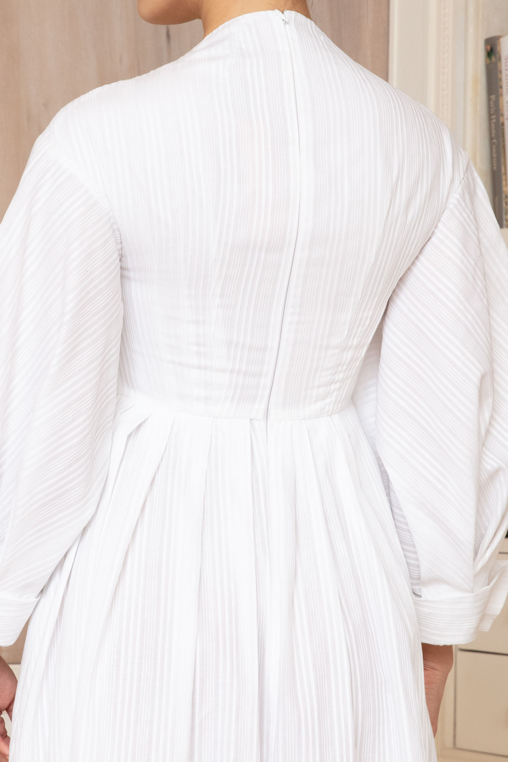 White surplice midi dress with sculpted cuff sleeves