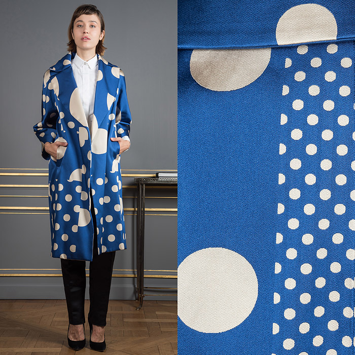 Blue coat with white polka dots